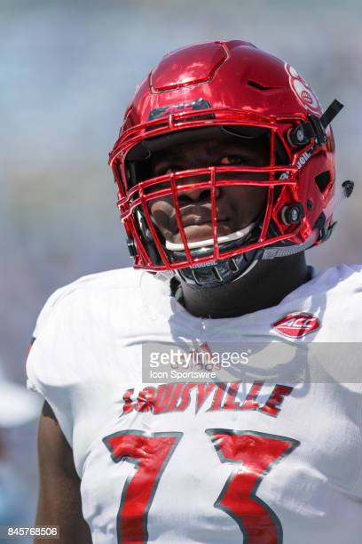 Louisville Cardinals offensive lineman Mekhi Becton warms up prior to a college football game between the Louisville Cardinals and the North Carolina...