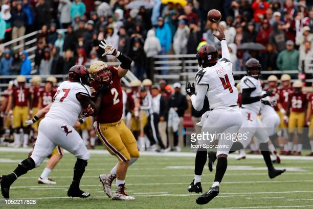 Louisville Cardinals quarterback Jawon Pass passes away from Boston College defensive end Zach Allen during a game between the Boston College Eagles...