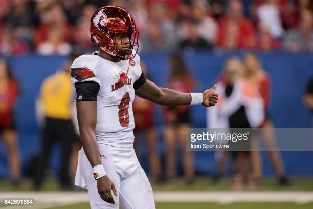 Louisville Cardinals quarterback Lamar Jackson gives the sidelines a thumbs up during the college football game between the Purdue Boilermakers and...