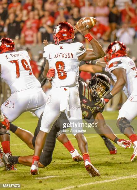 Louisville Cardinals quarterback Lamar Jackson passes with North Carolina State Wolfpack defensive end Bradley Chubb applying pressure during the...