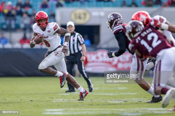 Louisville Cardinals quarterback Lamar Jackson runs during the game between the Louisville Cardinals and the Mississippi State Bulldogs on December...