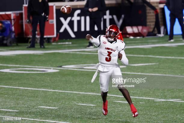 Louisville Cardinals quarterback Malik Cunningham tosses a pass during a game between the Boston College Eagles and the Louisville Cardinals on...