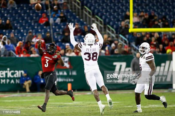 Louisville Cardinals quarterback Micale Cunningham passes over Mississippi State Bulldogs safety Fred Peters in the Franklin American Mortgage Music...
