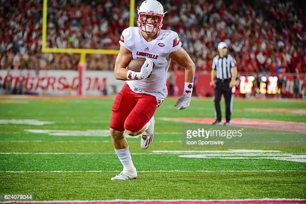 Louisville Cardinals tight end Cole Hikutini finds open field after a catch in the flat for a half touchdown during the NCAA football game between...