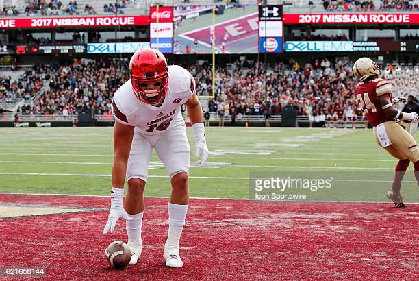 Louisville Cardinals tight end Cole Hikutini puts the ball down in the end zone after scoring during an ACC Division 1 NCAA football game between the...