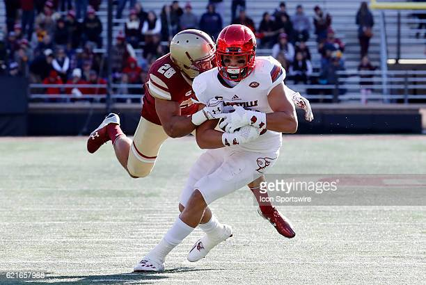 Louisville Cardinals tight end Cole Hikutini takes Boston College linebacker Matt Milano for a ride after a reception during an ACC Division 1 NCAA...