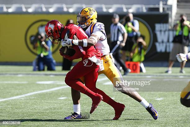 Louisville Cardinals wide receiver James Quick is tackled by LSU Tigers safety Jamal Adams after catching a pass in the 1st quarter of the 2016...