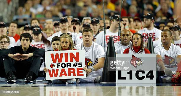 Louisville cheerleaders show their support of injured Kevin Ware as they face Wichita State in the second half ofa semi-final matchup in the NCAA...