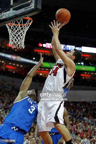 Louisville guard Kyle Kuric puts up a shot over Kentucky forward Terrence Jones during game action Kentucky defeated Louisville 7863 at the KFC Yum...