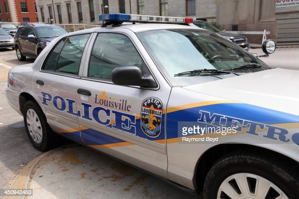 Louisville Metro Police car sits outside KFC Yum Center home of the Louisville Cardinals basketball team on May 30 2014 in Louisville Kentucky