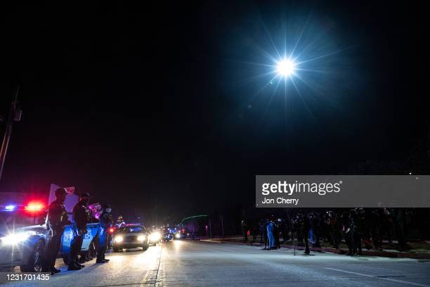 Louisville Metro Police Department officers face off a group of protesters after the Breonna Taylor memorial events on March 13, 2021 in Louisville,...