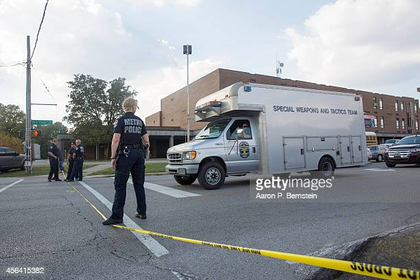 Louisville Metro SWAT van leaves Fern Creek High School after a shooting incident September 30 2014 in Louisville Kentucky Police say a male suspect...