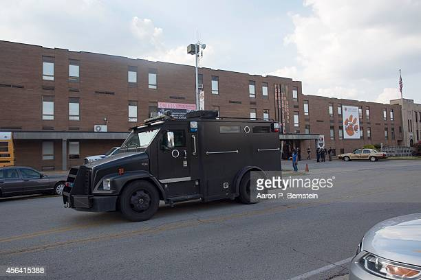 Louisville Metro SWAT vehicle leaves Fern Creek High School after a shooting incident September 30 2014 in Louisville Kentucky Police say a male...