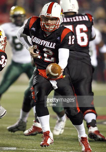 Louisville quarterback Brian Brohm looks to hand the ball off as the South Florida defense closes in during Saturday night at Papa John's Cardinal...