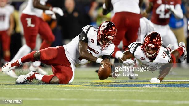 Louisville quarterback Jawon Pass and Louisville running back Colin Wilson dive to recover a fumbled snap during the first half of the Camping World...