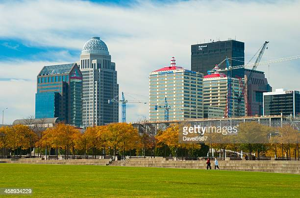 louisville skyline and people walking - louisville kentucky stock photos and pictures