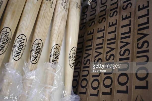 Louisville Slugger baseball bats sit on a table for packaging at the Hillerich Bradsby Co manufacturing facility in Louisville Kentucky US on...