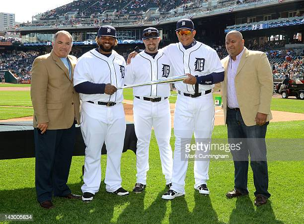 Louisville Slugger representative Lery Duran poses for a photo with Detroit Tigers Vice President and Assistant General Manager Al Avila, Prince...