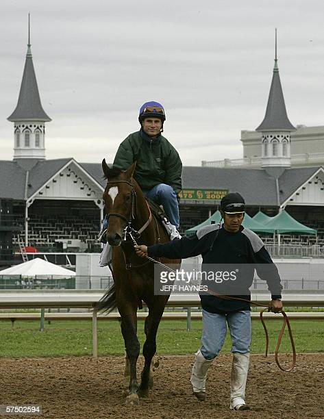Jockey Alex Solis aboard likely race favorite Brother Derek is lead off the track by hot walker Angel Rangel 01 May 2006 after his morning workout...