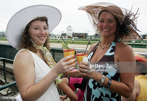 Laura Bishop and Catherine Dancy enjoy a mint julep 05 May 2007 at Churchill Downs in Louisville Kentucky before the 133rd running of the Kentucky...