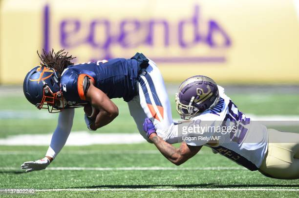 Louis Young of the Atlanta Legends tackles Donteea Dye Jr #11 of the Orlando Apollos during the first half in an Alliance of American Football game...