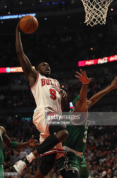Loul Deng of the Chicago Bulls drives to the basket past Paul Pierce of the Boston Celtics at United Center on April 7 2011 in Chicago Illinois The...