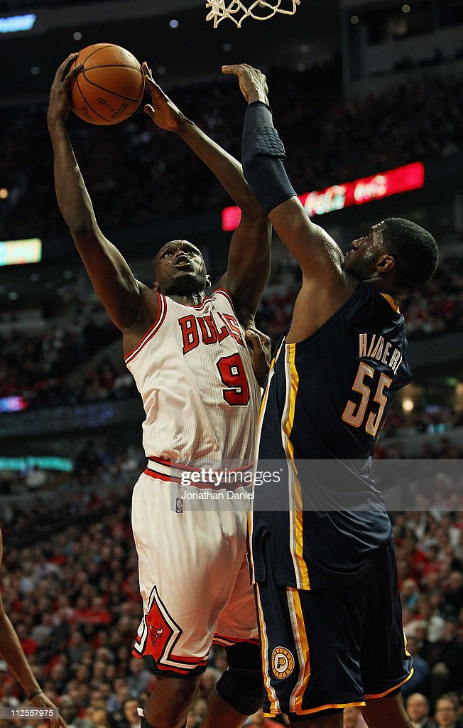 Loul Deng #9 of the Chicago Bulls puts up a shot against Roy Hibbert #55 of the Indiana Pacers in Game Two of the Eastern Conference Quarterfinals in the 2011 NBA Playoffs at the United Center on April 18, 2011 in Chicago, Illinois. The Bulls defeated the Pacers 96-90.
