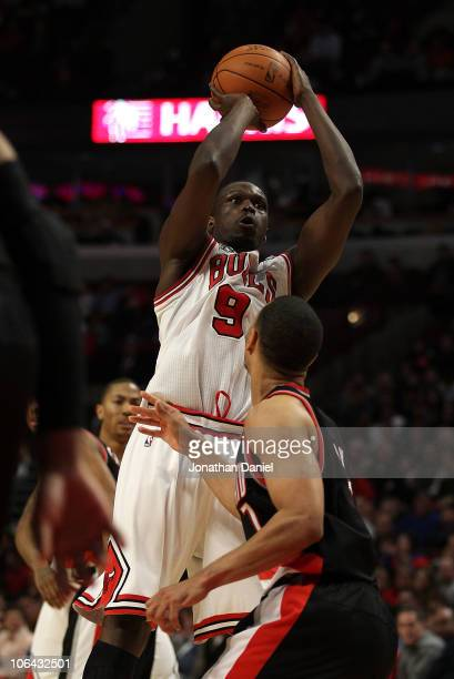 Loul Deng of the Chicago Bulls puts up a shot over Brandon Roy of the Portland Trail Blazers on his way to a gamehigh 40 points at the United Center...