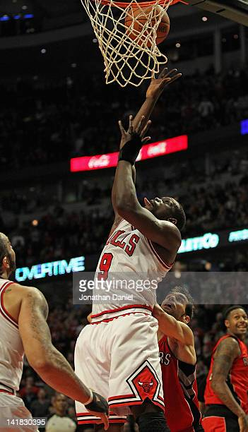 Loul Deng of the Chicago Bulls puts up the game-winning shot against the Toronto Raptors at the United Center on March 24, 2012 in Chicago, Illinois....