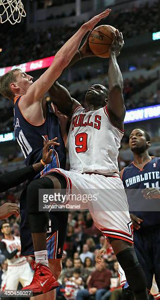 Loul Deng of the Chicago Bulls shoots against Cody Zeller of the Charlotte Bobcats on his way to a gamehigh 21 points at the United Center on...