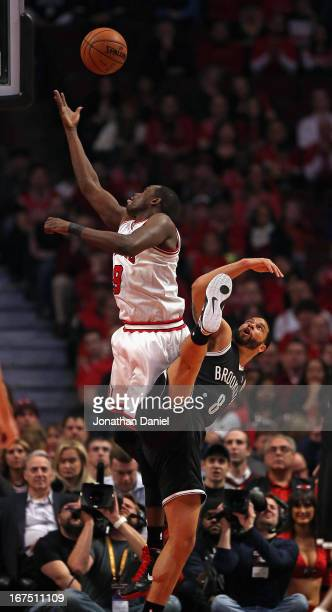 Loul Deng of the Chicago Bulls shoots over Deron Williams of the Brooklyn Nets in Game Three of the Eastern Conference Quarterfinals during the 2013...