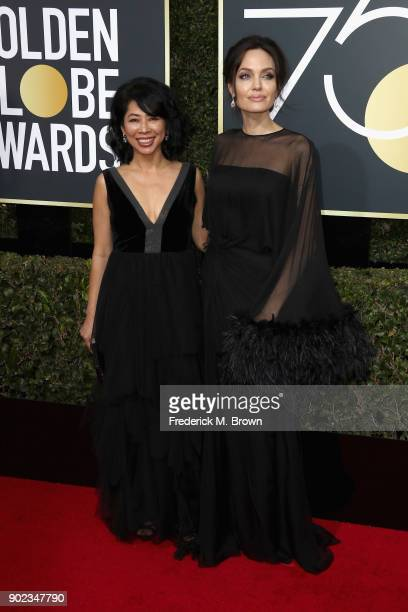 Loung Ung and Angelina Jolie attends The 75th Annual Golden Globe Awards at The Beverly Hilton Hotel on January 7 2018 in Beverly Hills California