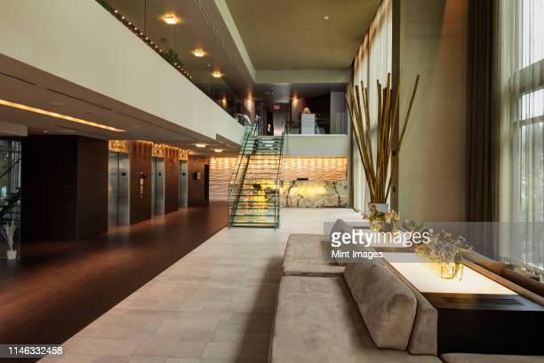 lounge area in hotel lobby - ロビー ストックフォトと画像