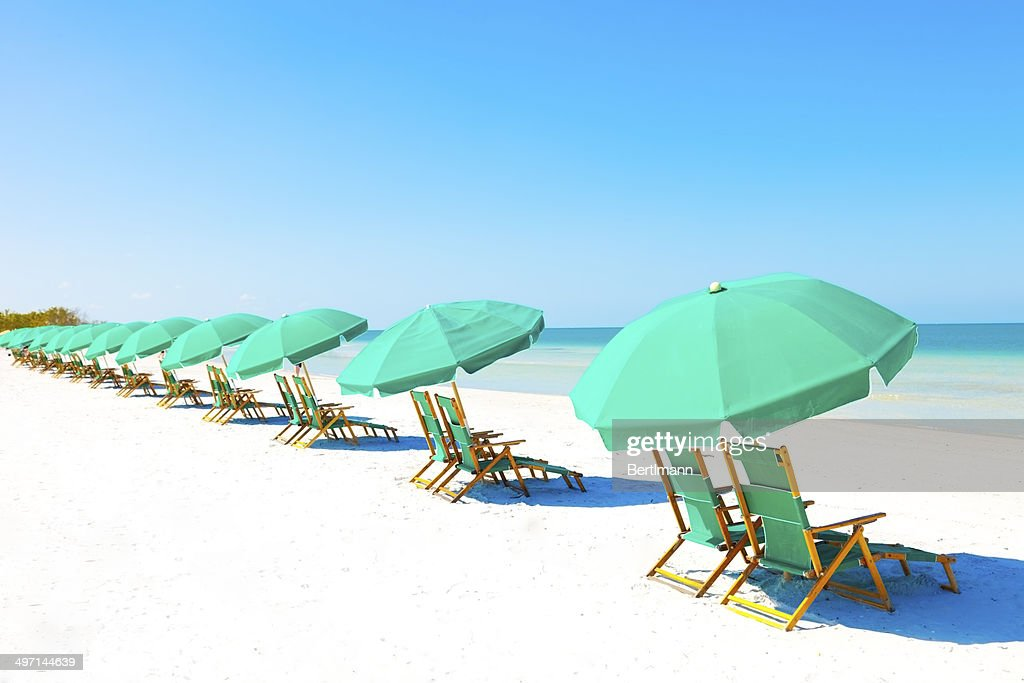 Lounge Chairs and Umbrella at the Beach : Stock Photo