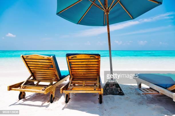 Lounge chairs at Canareef Resort Maldives, Herathera island, Addu atoll