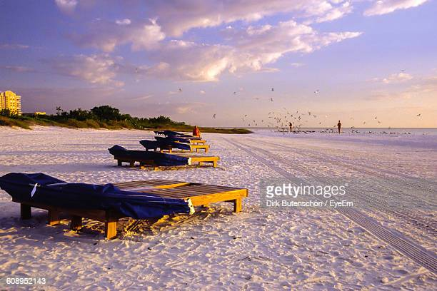 lounge chairs at fort myers beach during winter - fort myers beach stock pictures, royalty-free photos & images