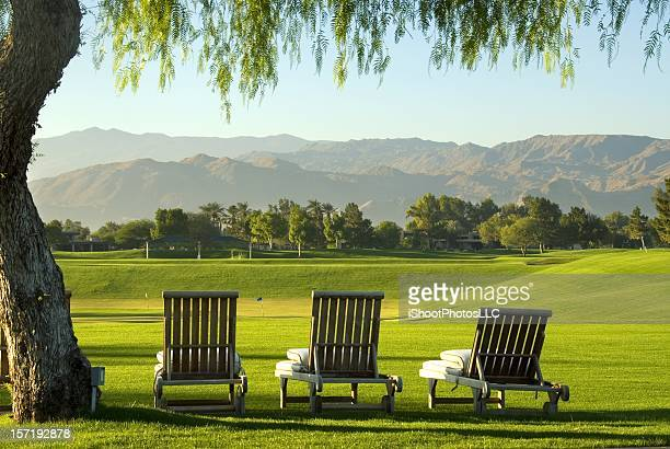 Lounge chairs overlooking a golf course