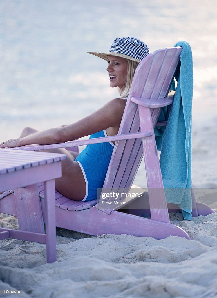 Remarkable Lounging In Beach Chair High Res Stock Photo Getty Images Ocoug Best Dining Table And Chair Ideas Images Ocougorg