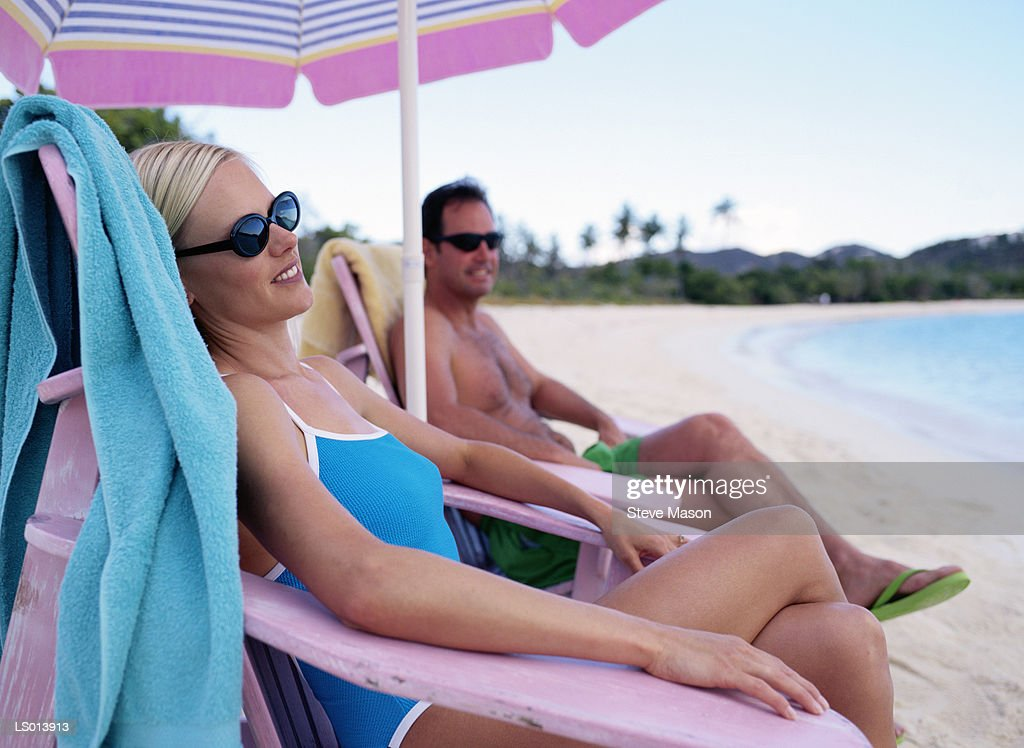 Pleasant Lounging In Beach Chairs High Res Stock Photo Getty Images Ocoug Best Dining Table And Chair Ideas Images Ocougorg