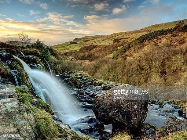 loup of fintry waterfall, central scotland. - stirling stock pictures, royalty-free photos & images