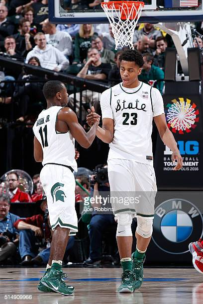 Lourawls Nairn Jr #11 and Deyonta Davis of the Michigan State Spartans celebrate against the Ohio State Buckeyes in the quarterfinal round of the Big...