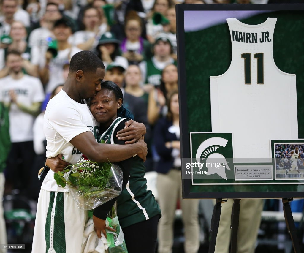 Lourawls Nairn Jr. #11 of the Michigan State Spartans and his mother share a moment during the senior day video after a basketball game between the Michigan State Spartans and the Illinois Fighting Illini at Breslin Center on February 20, 2018 in East Lansing, Michigan.