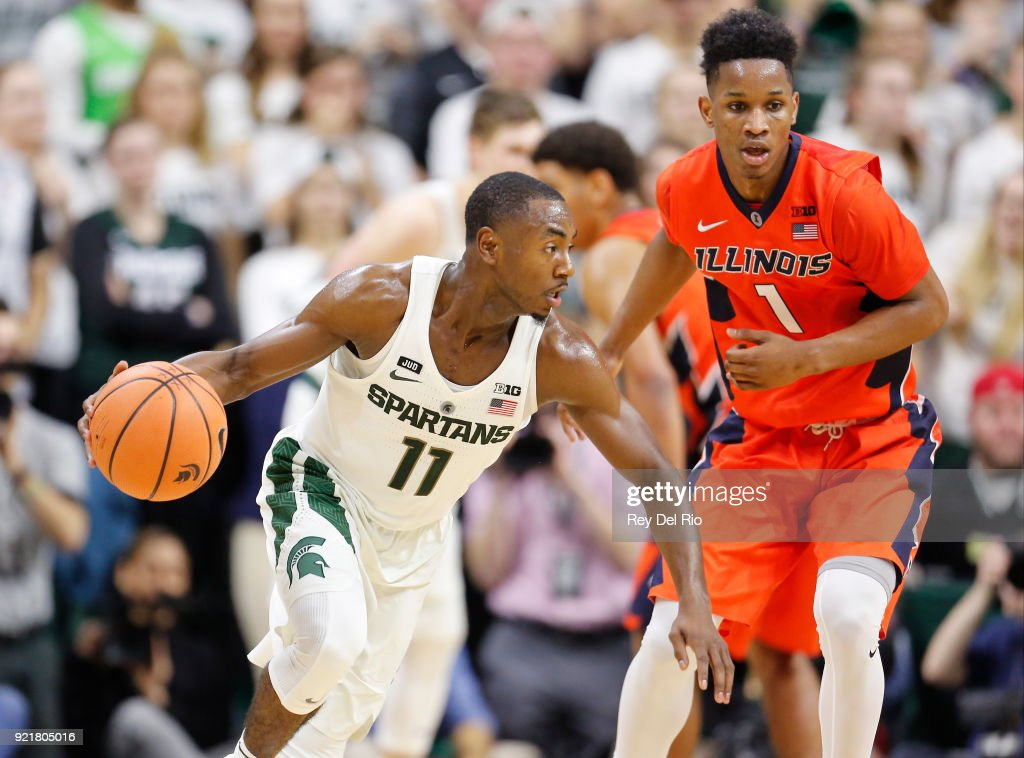 Lourawls Nairn Jr. #11 of the Michigan State Spartans drives to the basket while defended by Trent Frazier #1 of the Illinois Fighting Illini in the second half at the Breslin Center on February 20, 2018 in East Lansing, Michigan.