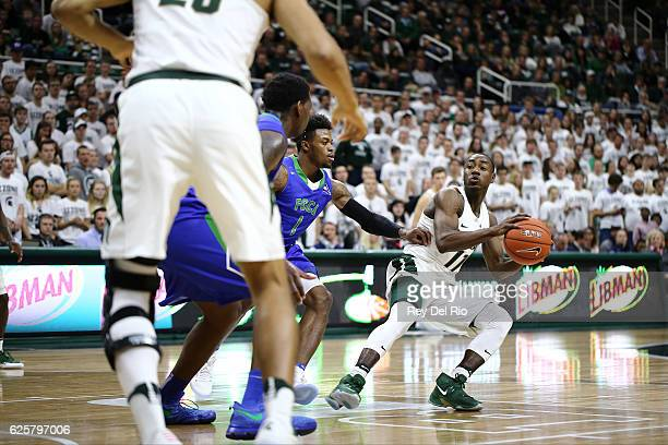Lourawls Nairn Jr #11 of the Michigan State Spartans handles the ball in the second half against Reggie Reid of the Florida Gulf Coast Eagleson...