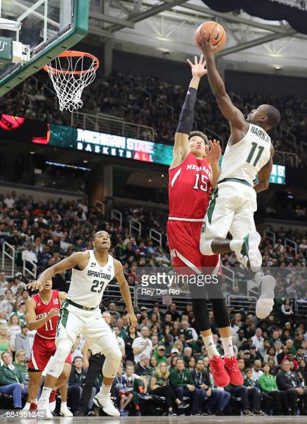 Lourawls Nairn Jr #11 of the Michigan State Spartans shoots a layup against Isaiah Roby of the Nebraska Cornhuskers at Breslin Center on December 3...
