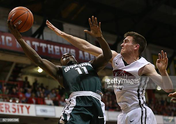 Lourawls Nairn Jr. #11 of the Michigan State Spartans shoots over Caleb Donnelly of the Northeastern Huskies in the second half on December 19, 2015...