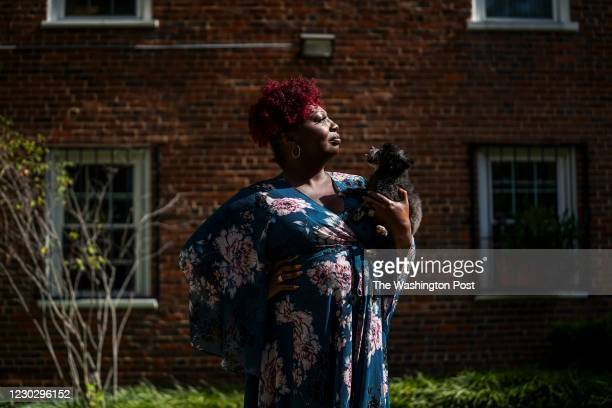Lourdes Ashley Hunter and Cashmere, a teacup Pomeranian, stand for portraits in front of the apartment building where they live in Washington, DC, on...
