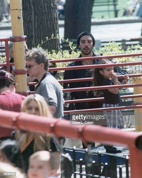 Lourdes Ciccone Leon right plays in Central Park under the watchful eye of her father Carlos Leon in the fall of 2000 in New York City Lourdes is the...