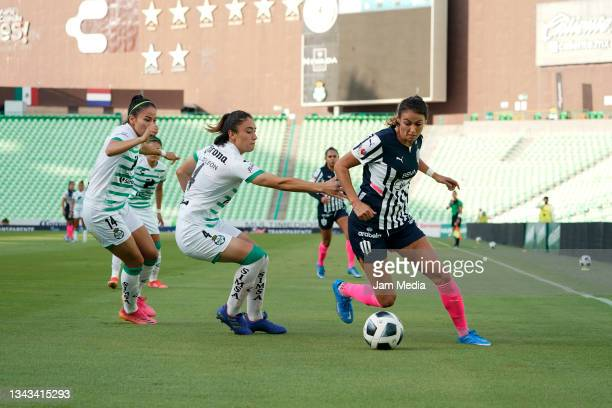 Lourdes De Leon of Santos fights for the ball with Christina Burkenroad of Monterrey during a match between Santos and Monterrey as part of the...