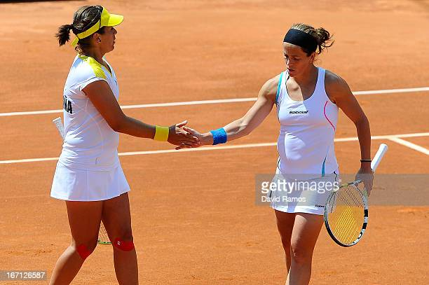 Lourdes Dominguez and Anabel Medina chat during their double match against Shuko Aoyama and Misaki Doi of Japan during the day two of the Fed Cup...